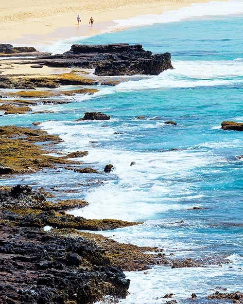 Seascape: People walking on a beach Sandy Beach, Oahu, Hawaii